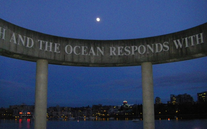 May 3rd along the False Creek seawall, the 'nearly full super-moon' is positioned beyond the massive earth and moon sculpture.